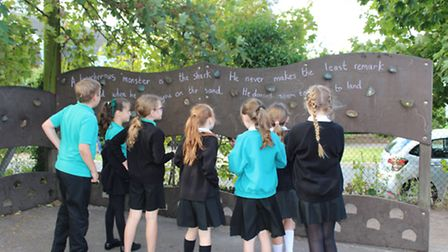 A graffiti artist came and scribbled famous quotes on St Mary's Primary School in Dunmow for Nationa