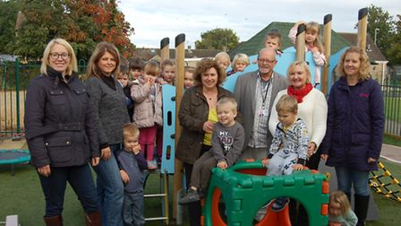 John Ellerby with children from Isleham Pre-School and their families.