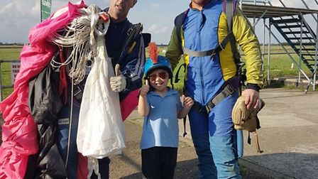 Chris and his son after his skydive.