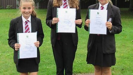 Ellie Waters (right) received a Cross pen with her name engraved on it, a certificate and family tic