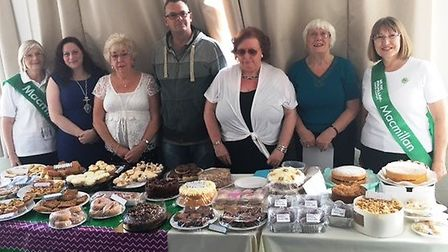 Macmillan committee representatives with organisers of the coffee morning.