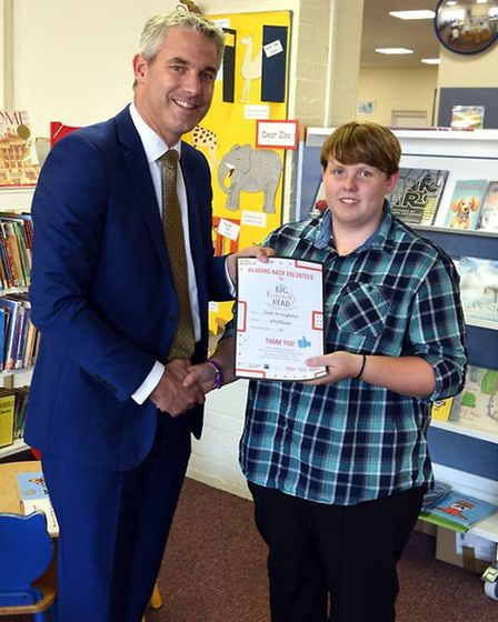 MP Steve Barclay presents certificates to youngsters in Whittlesey who completed the 'Read to Succee