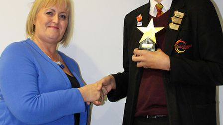 Tracey Palmer presents the prize to Billy Griffiths