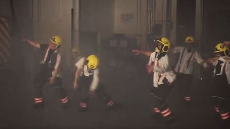 The firefighters dress up as zombies in the safety video.