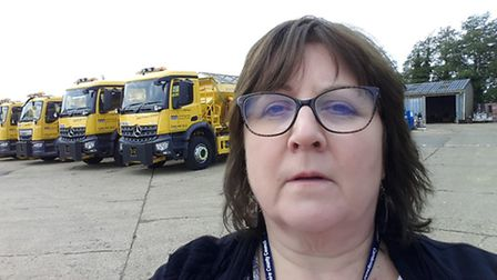 Cllr Lorna Dupré with local gritting lorries