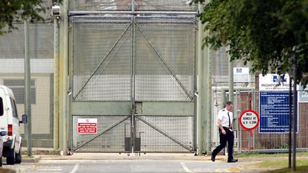 A Prison Officer at walking past the gates of HMP Highpoint Prison in Suffolk where Tony Martin has