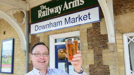 In better days: Ian Pinches outside The Railway Arms in Downham Market, after it won the national CA