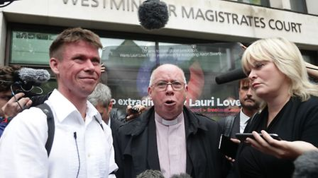 Lauri Love (left), with father Rev Alexander Love outside Westminster Magistrates' Court, London. Ph