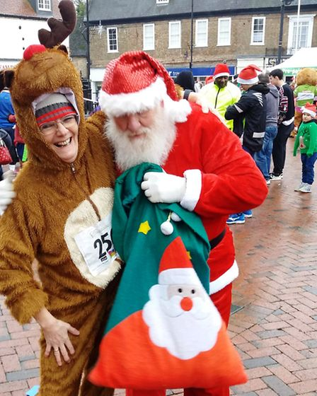 Mr Webb as Santa having a chuckle with Ruby the running loose Reindeer