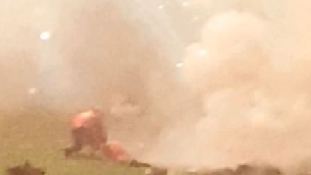 Bystander captures the moment a faulty firework exploded in a man's face at Ely's display
