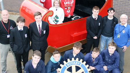 Students from Cromwell Community College reveal handmade sleigh for rotary club.
