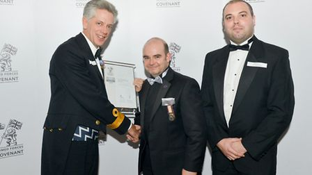 Forces Recruitment receive their award from left: The Royal Navy Regional Commander for Eastern Engl