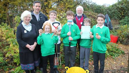 Mr Poli, head of outdoor learning with pupils from Ely St John's primary school in the school's allo