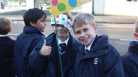 King's Ely pupils line the streets to wave the BBC Children in Need Rickshaw Challenge Team on