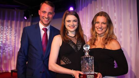 Josh Schumann with the Show Must go on award given to Becky Bush & Katie Shearman, who sang the Evit