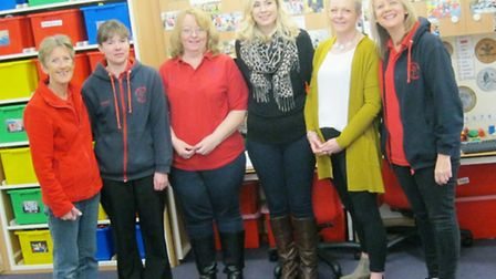 Children and staff at Littleport Community Pre-School celebrate their 'good' Ofsted rating.
