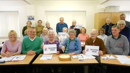Attendees at Cambridgeshire ACRE Village Hall Coffee Morning enjoying cake to celebrate National Tru