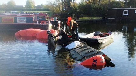 A military vehicle, the OT64, is raised from the river where it snak during a test run at Fox's Boat