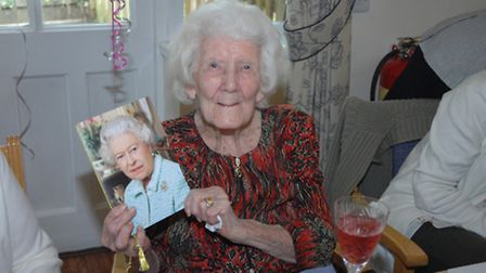 Mary Powell with her card from the Queen
