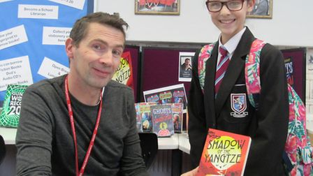 Author Julian Sedgwick with a Cromwell Community College student