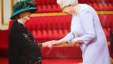 Pioneer teacher Robyn Dalby-Stockwell received an MBE, for services to children, from the Queen in B