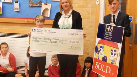 Glebelands Primary School receive £400 from sales manager Sharon Aylward and her colleague Jordan Ma