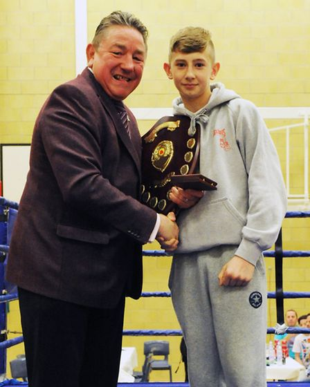 Reece Lennon receives the 'Best Boxer of the Night' award from Dave 'Boy' Green.