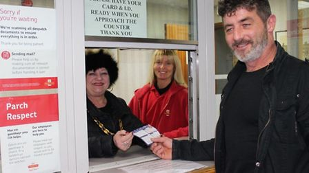 Visitors to the Royal Mail's delivery office in Wisbech got a pre-Christmas surprise - manning the c
