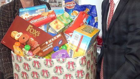 Sales negotiator Myra Alvin with colleague Jordan Martin and some of the donated items.