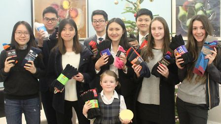 Niamh, front, with King's Ely students who helped with the Socks and Chocs charity campaign.