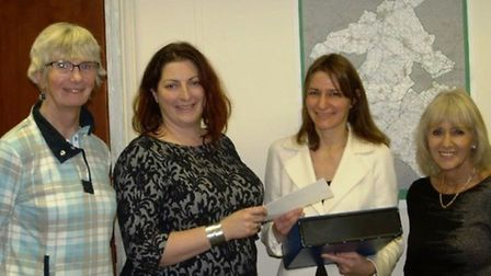Petition about the MIU units is handed to MP Lucy Frazer. Pictured left to right: Helen Wright, Emma
