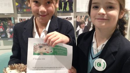 Evie Boughton and Isabel Booth with their hedgehogs.