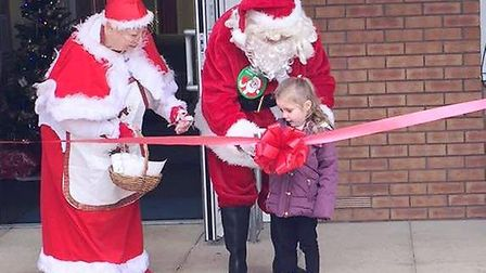 Father Christmas cuts the ribbon to officially open the new Maple Grove Community Group pre-school e