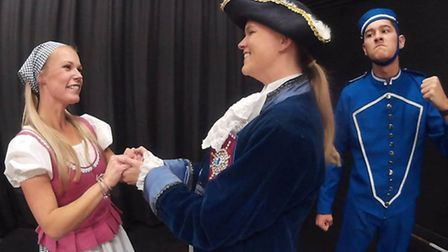 Cinderella (Nikki Dyer) and Prince Charming (Lacey Kiefer) and Buttons (George Harrison).
