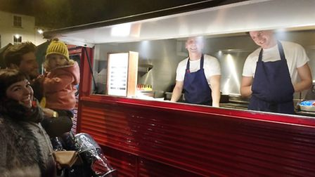 Shoppers enjoying food from Steak and Honour at Ely Market Team's Festive Lates.