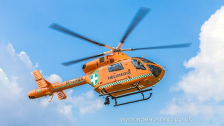 Woman in her 50s airlifted to hospital with serious leg injury after collision with car in Creek Roa