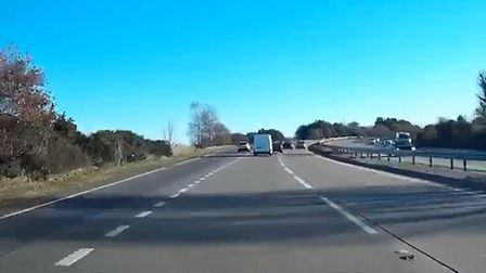 Images from Trimley man Charlie Burton's dashcam footage of a driver travelling the wrong way along