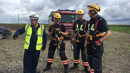 Cambridgeshire firefighters take part in emergency training exercise... atop 60-metre high wind turb