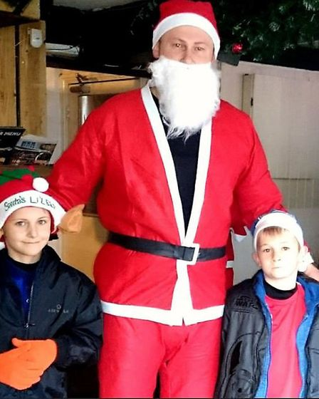 Santa with his little helpers.