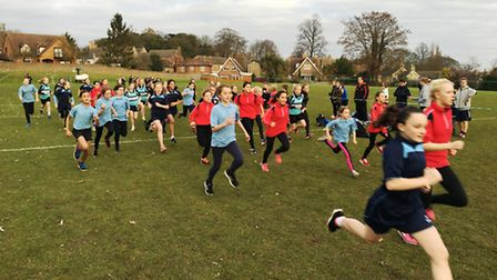 Action from the Isle of Ely District Cross Country.