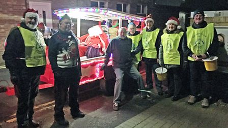 Santa Claus and his band of festive followers from the Ely Rotary Clubs.