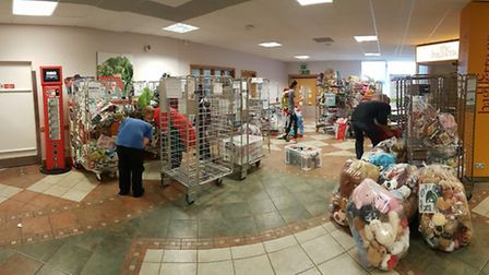 Sorting through hundreds of donated toys and gifts.