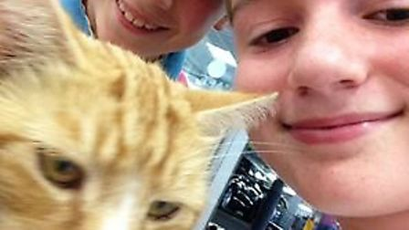 Garfield fans Ethan and Jack Davey with the popular cat outside Sainsbury's in Ely