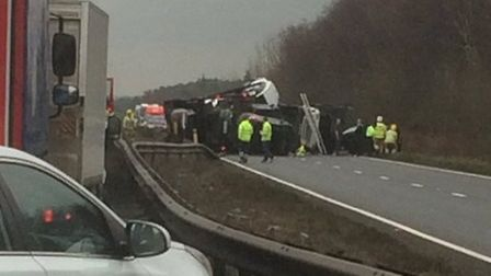 Emergency services at the scene of the accident on the A11 after a car transporter crashed into the