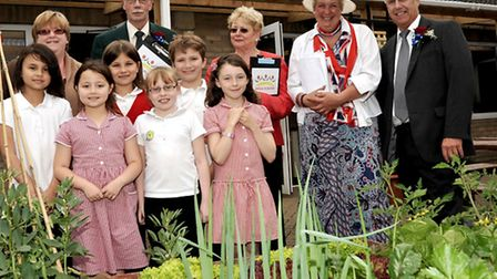 Chatteris in Bloom judging. Children from Glebelands Primary School show the Anglia in Bloom Judges