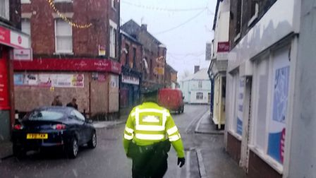 Police on patrol this morning in Wisbech as snow falls.