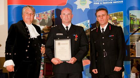 Cambridgehisre Fire and Rescue Group Commander Karl Bowden (centre)