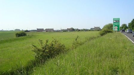 View of the proposed site of Griffin Roses new shed from the A141 showing adjacent buildings