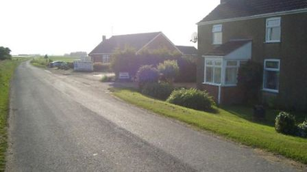 Front view of the buildings oppose to the site of Griffin Roses proposed new shed in March