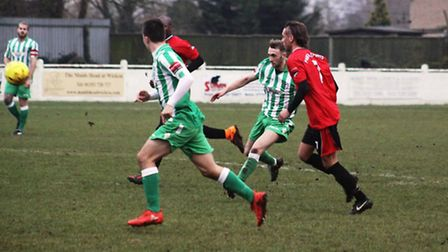 Action from Soham Town Rangers' 1-0 defeat to Phoenix Sports. Photo: Andy Burford